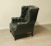 Pair Of Dark Green Leather Wing Chairs